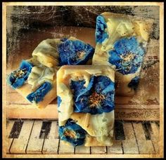 Image of hand-sculpted soap embeds, both hot process and cold process. No tutorial at this site. -Tentance