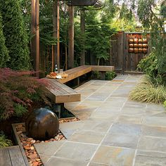 Chic cut-stone walkway    Pebbles are too smooth and round to make a suitable paving if left free to roll around. But when set in concrete with their flattest side up, they create a perfectly navigable path with an interesting texture.