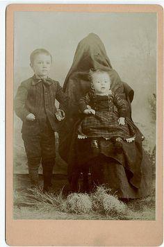 Hidden mothers in Victorian photos.  Haunting...