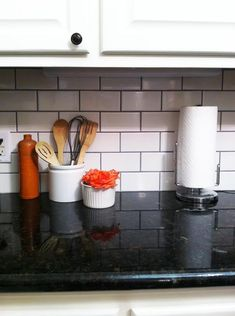 Trendspotting: White tile paired with dark grout. Black grout holds up better against stains... and it looks so cool.