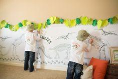 A fun coloring wall party activity at a Dino Dig Themed Birthday Party via Kara's Party Ideas KarasPartyIdeas.com #dinosaurparty #dinoparty #dinodig #dinopartyideas #partydecor #partyactivity