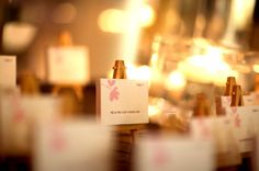Escort cards set up as mini canvas art gallery.  {Photo by Kevin Weinstein} #weddings