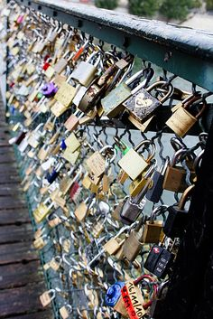 This is the love lock bridge in Paris, France. You write you and your lover's name on the lock and then throw the key into the Seine. I can't wait to go back with Libjeer and show him our lock!