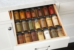 Streamline spices to be more accessible without cluttering the counters. Add a drawer insert to keep spices visible near the stove. When you refill a jar, pop a label on the bottom with the date. After 6 months, ground spices can lose much of their flavor.