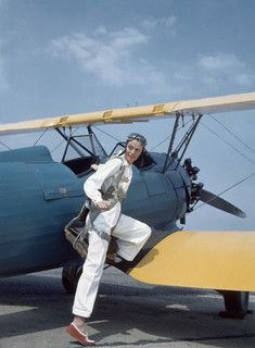 Model Sandy Rice, in pilot's gear, stepping onto Waco Trainer biplane at Roosevelt Field, 1941. #vintage #airplane #1940s