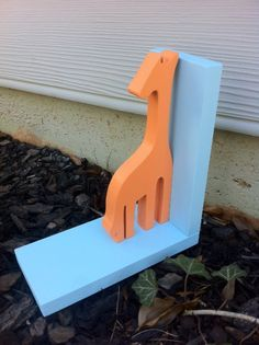 Orange Giraffe with Blue Base Bookend  Price is by ProfessorFinley, $25.00