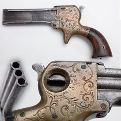 Marston Three Barrel Derringer - About 1,500 derringers in .22 caliber were produced by William W. Marston of New York City from 1858 to 1864. His design included two unusual features: a selector switch to choose which barrel to fire and lso a sliding knife that mounted on the side of the barrels. While our example is missing the blade (anybody got a spare?), our selector still functions normally and is set up for barrel #2 at present. NRA National Firearms Museum in Fairfax, VA