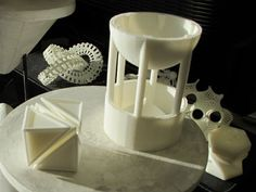 How 3D Printing can make visualizing a geometrical proof so much easier. One of Archimedes' proofs showed  that a sphere that fits exactly inside a cylinder fills two thirds of its volume. Elizabeth Slavkovsky and Oliver Knill of Harvard University  printed a hollow hemisphere supported above a cylinder which contains a cone that takes up one third of the cylinder's volume. Fill the hemisphere with water and it drains into the cylinder, filling it exactly to the brim. #Math #3D_Printing