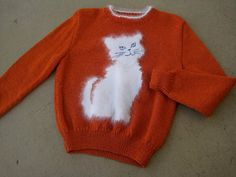 PURRRTY PURRRFECT if you ask me. vintage sweater, my wandering eye (etsy)