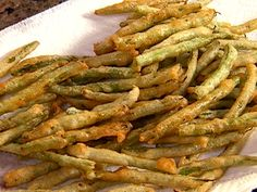 Food Network invites you to try this Fried Green Beans recipe from Patrick and Gina Neely.