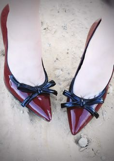 ruby slippers with black bows