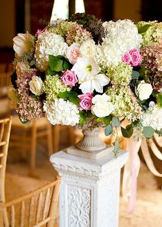 Large, rounded ceremony arrangement.