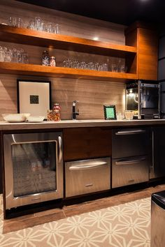 If media room is downstairs, then need a little snack bar. Would only need a mini fridge, popcorn maker, ice maker, and some cabinetry for glasses/bowls/snacks etc.