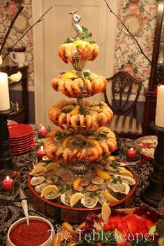Shrimp cocktail tower with oyster in the half shell on the bottom over ice