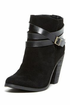 Black ankle boots--Make sure you can walk comfortably in them!  Great with jeans, casual dresses, black pencil skirt with tights.   (chicfoo)
