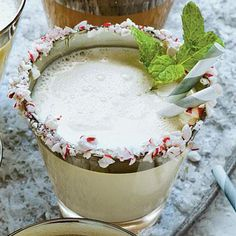 Mint-and-White-Chocolate Milk Punch | This punch features all the flavors of the holiday season. For a wintry, festive rim to your milk punch, crush peppermint sticks, dip your cup in corn syrup, and dip again in the peppermint. | SouthernLiving.com