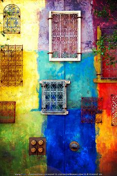 Grated Windows on Color Splashed Wall