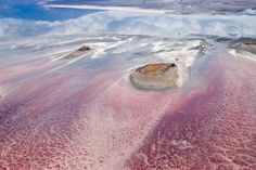 Lake Natron, Tanzania by udphoto: Arguably the most caustic lake in the world, this shallow salt lake is fed by the Southern Ewaso Ng'iro River and also by mineral-rich hot springs. High levels of evaporation leave concentrations of salt and sodoium carbonate (natron). The red color is due to spiriulina, a blue-green algae with red pigments. #Photography #Lake_Natron #Tanzania