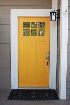 mustard yellow door.Needs to be with a darker, grayer siding color.