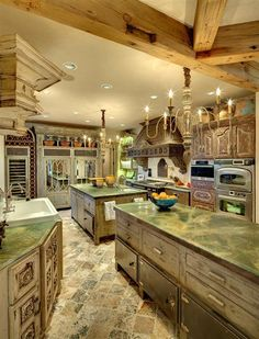 Dripping with too many details to mention and all of the functionality that any cook could wish for. The two islands are old French pastry tables!~