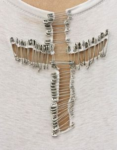 Creative idea: cut out a cross and connect it with a ton of safety pins. #sewing #DIY