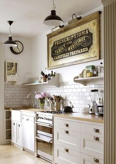white kitchen with vintage sign