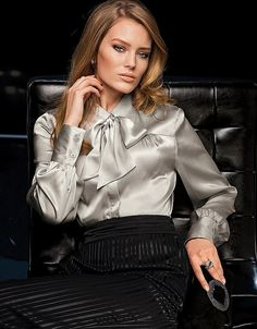 .soft gray satin blouse with black pencil skirt that has silver threads on black