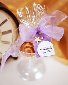 Send guests off with a midnight snack of mini muffins or mini cinnamon buns packaged in a cellophane bag.