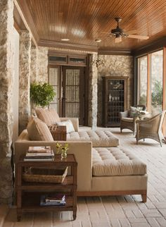 Sunroom with Brick Floor, Comfy Chaise Lounges, Stone Walls, and Wood Ceiling.