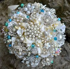 Tiffany blue brooch bouquet. Using my babies' birthstones. Sapphires and pearls.