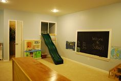 "The ladder leads up to a ""fort"" that has a trap door in the floor. The door leads to a hidden room below. A repurposed boat hatch provides ""escape"" to the closet space pictured. The slide is another fun way to get down from the fort! The chalkboard with authentic ledge provides the perfect setting for playing school! Out of the photo to the right, a wall-mounted mirror lets kids check out their dressup ensemble."
