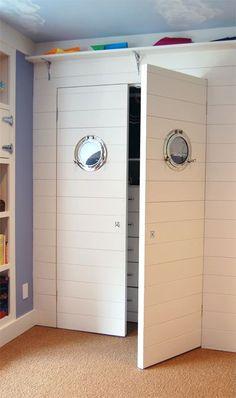Porthole mirrors on a closet for a nautical room