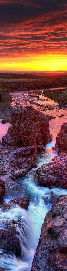 The waterfall cavern at sunset in Northern Iceland
