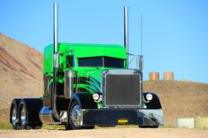 It's not so much the graphics that capture the attention as it is the color combo of Wes Malmgren's Peterbilt 379. The black and lime green flattop, an in-house build done at the Malmgren family's company headquarters in Aurora, Utah, is the rebel amongst a fleet of more refined workhorses. For full story, visit www.customrigsmag.com/wicked-green custom rig, big truck, big rig, peterbilt truck, lime, semi, larg car, peterbilt 379, custom peterbilt