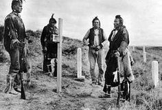 Crow Scouts visiting the Little Bighorn battlefield, circa 1913. From left to right: White Man Runs Him, Hairy Moccasin, Curly, and Goes Ahead. Curley was the last man on the army side to see Custer and the 7th Calvary alive. He was later buried at the National Cemetery of the Big Horn Battlefield.