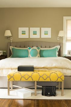 House of Turquoise: Nifelle Design Fine Interiors - gray tufted upholstered platform bed with turquoise pillows and a yellow bedroom bench