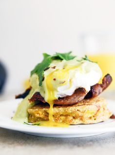 These sweet corn cakes are topped with poached eggs and avocado hollandaise.