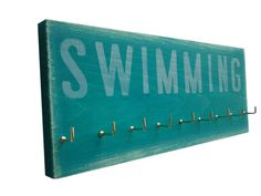 For swim & gymnastics ribbons.  Swimming Use a Medals Rack to display your by runningonthewall, $28.00  Fun to hang ribbons and awards for the kids.