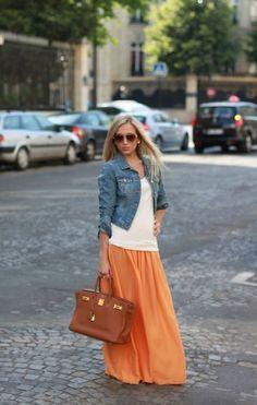 Orange maxi skirt, white top, denim jacket, brown bag. cute.