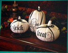Painted foam pumpkins with vinyl letters