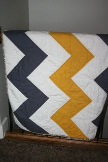 Yellow and grey chevron quilt.