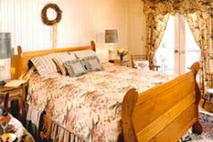 Room 10: Traditional Guest Room located on the second floor with a queen bed, balcony, and a private bathroom with a tiled shower. $359.00 MAP, $319.00 B&B