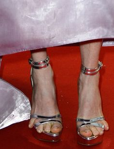 Bonus Entry: Celebrity Worst Heeled Moment We interrupt this countdown to bring you a 2013 celebrity worst heeled moment. The usually elegant Julianne Moore unfortunately got it toe-tally wrong at the Cannes Film Festival Opening Ceremony when her pinky toe runneth over. Or maybe she's trying to start a reverse flip flop trend? Source: Oddities123.com  #flipflop #heel #freeyourtoes #juliannemoore #celebrity