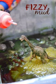 FIZZY MUD in an easy to make sensory mud that FIZZES as kids play.  SO FUN!  I mean, what could be cooler than a fizzing dinosaur world?  Or a muddy snake swamp?  Or fizzing mud pies {So many ways to PLAY!}