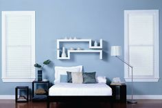 A nearly bare wall of Behr's plae blue Heron makes a stunning statement against minimal decor. | Photo: Courtesy of Behr | thisoldhouse.com