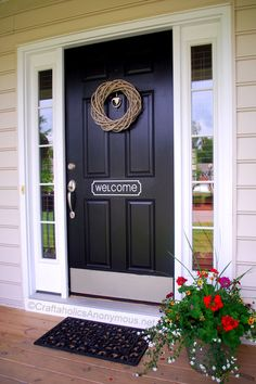 Black door with white surround ~ definitely talking my husband into doing this!! Just looks classy & warms up the front!