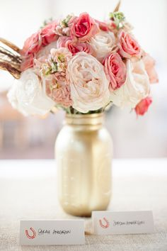 Pink + Coral + a Gold Mason Jar. Love it! Paper Antler Photography | On SMP:  http://www.StyleMePretty.com/2013/01/30/vail-colorado-wedding-from-sweet-pea-flowers/