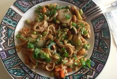 Easy Pad Thai with Cilantro and Scallions and Peanut butter and party nuts! Simple and scrumptious!