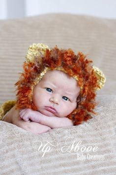 even though this baby's 4 weeks old, he still knows someone put something horrible on his head...look at his face!  Wait.. or else he is pooping. baby boy photos, baby headbands, crochet baby hats, photo props, hat patterns, clothes patterns, crochet patterns, lion hat, baby photos