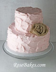 Rustic Pink Buttercream Cake with a Burlap Rose.  This cake would be perfect for a baby shower, bridal shower or wedding cake!  Click over for more pics and details!